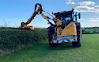 Robert duffin hedge laying fencing groundwork  with Hedge cutter at Saxby