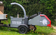 Adam gibson treecare specialist with Wood chipper at Greatham