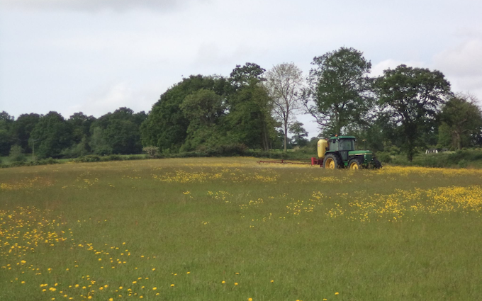 Belsham farming with Tractor-mounted sprayer at United Kingdom