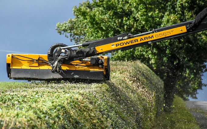 Jd fowles & partners  with Hedge cutter at United Kingdom