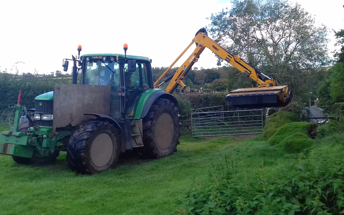 Seggons contractors with Hedge cutter at Loxhore