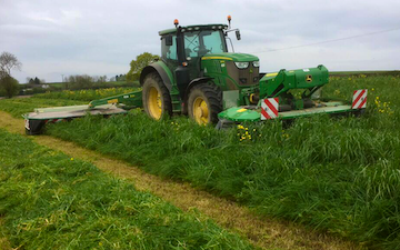 N.r phillips agricultural contracting services  with Mower at Duffryn