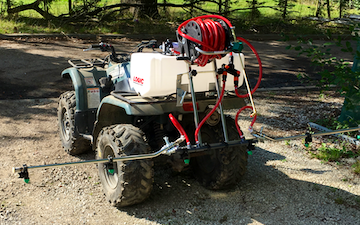 T.fannon services with ATV sprayer at United Kingdom