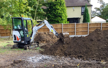 Am services with Mini digger at Sutton
