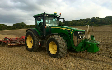 Cornbury farm contracting ltd with Disc harrow at West Lavington
