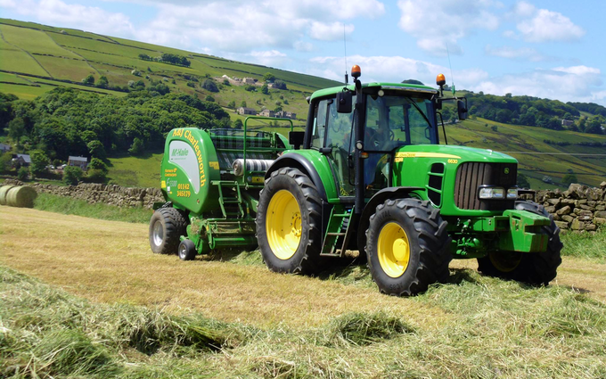 A & sj charlesworth farmers and contractors with Round baler at Loxley