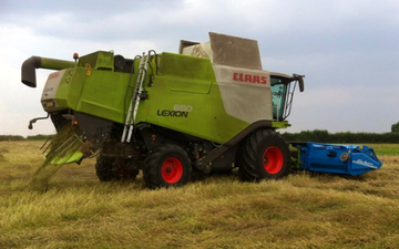 Girsby farm services ltd with Combine harvester at Girsby Lane