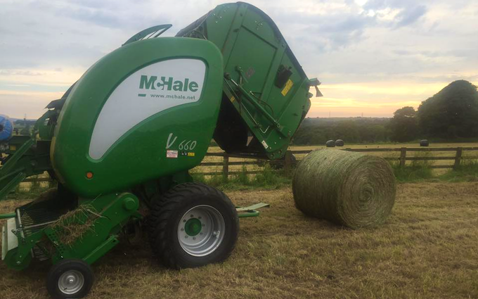 Adam & sons agri services with Round baler at United Kingdom