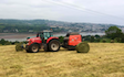 Wildwoods contractors with Round baler at United Kingdom