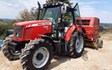 Clarke farming and contracting  with Round baler at United Kingdom
