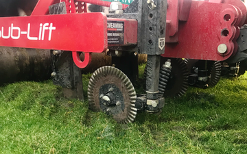 Jr king and son with Meadow aerator at United Kingdom