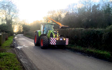 A. farrell contracting with Hedge cutter at Hellington
