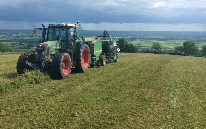 Jones agricultural contracting  with Round baler at Moorland Street