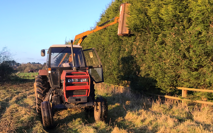 Otg paddock maintenance with Hedge cutter at United Kingdom