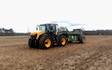 J. steel contracting  with Lime spreader at Cauldhame Farm Road