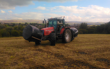 J brierley agricultural with Bale chaser at Rochdale