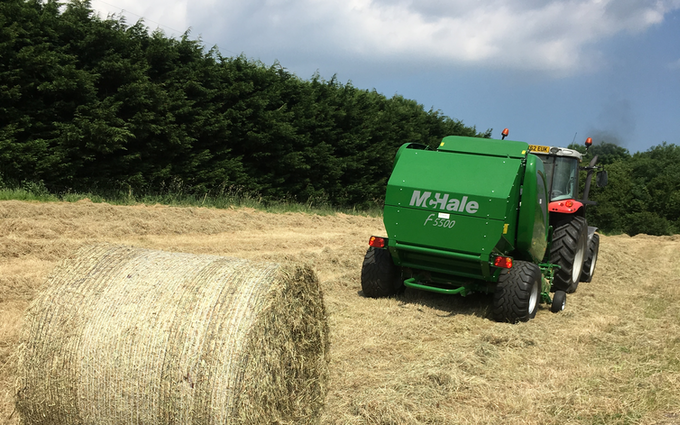 Spencer & sons agricultural services with Round baler at Totnes