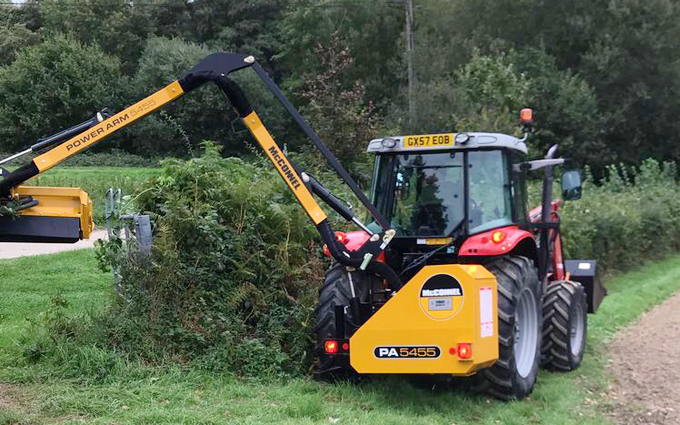 Douch contracting  with Hedge cutter at United Kingdom