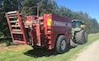 Roger smith contracting  with Large square baler at Braebrook Drive