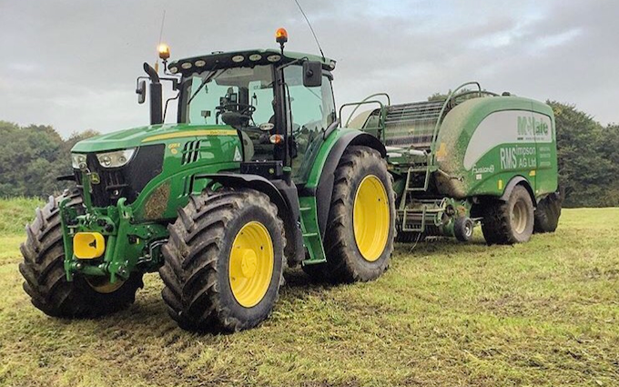 R.m simpson agriculture ltd with Round baler at Hunsworth Lane
