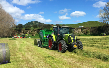 Bruce gordon contracting  with Round baler at Marton