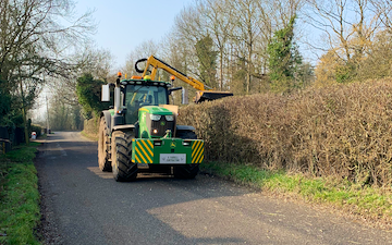 A. farrell contracting with Hedge cutter at United Kingdom