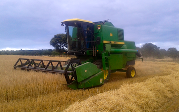 A & sj charlesworth farmers and contractors with Combine harvester at Loxley