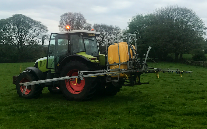 Dan beaumont with Large square baler at United Kingdom