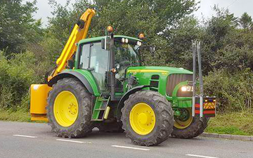 Dan hirst agricultural contractors  with Hedge cutter at United Kingdom