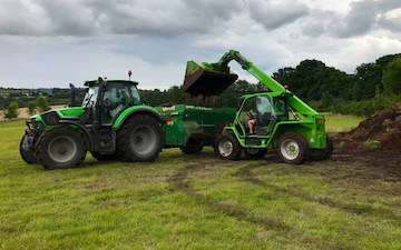 Belsham farming with Manure/waste spreader at United Kingdom