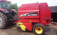 T. bannister and son with Round baler at Barnes Drove