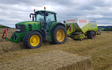 E.j & j.c.j brook agricultural contractors with Large square baler at Exeter