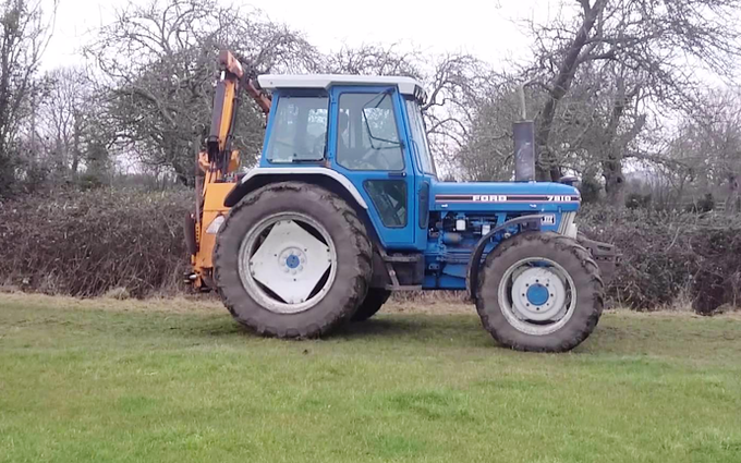 T.j saunders contracting with Hedge cutter at Upton Saint Leonards