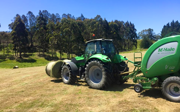 Richard templeton contracting ltd with Round baler at Waitati