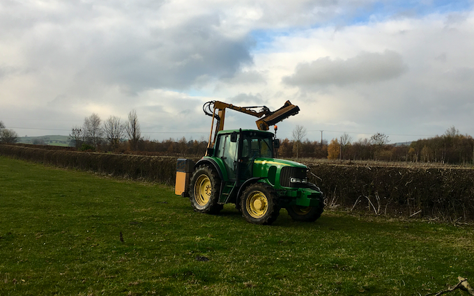 P g evans  with Hedge cutter at Caerwys