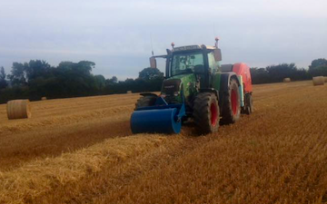 C r ellis contracting  with Round baler at Axminster