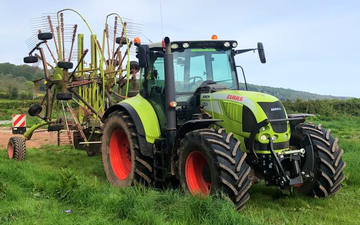 K m bray agri & plant contractor  with Rake at Talgarth