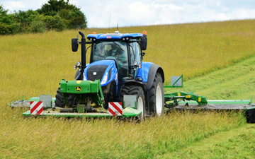 Cornbury farm contracting ltd with Mower at West Lavington