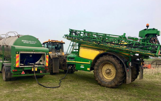 H c beales and co with Trailed sprayer at Great Ellingham
