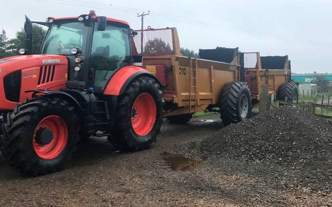 Jr king and son with Manure/waste spreader at United Kingdom