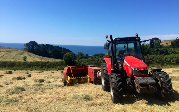 Spencer & sons agricultural services with Small square baler at Totnes