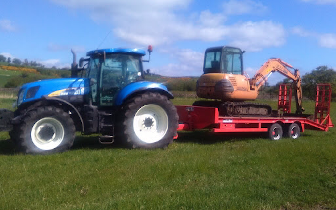 M. j. stanworth agricultural contractor with Low loader at Foulridge