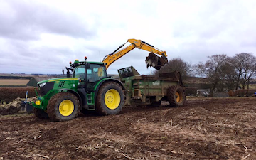 M & m bell contractors with Manure/waste spreader at United Kingdom