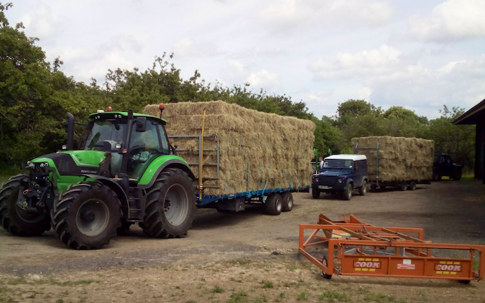 Belsham farming with Small square baler at United Kingdom