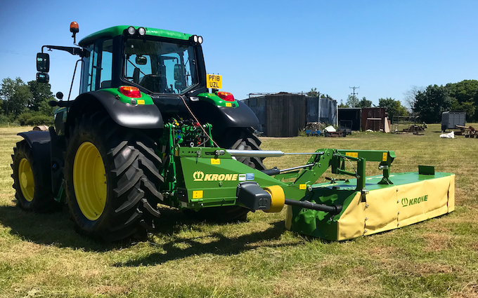 Edwards agricultural services  with Round baler at Chorley