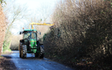 Belsham farming with Hedge cutter at United Kingdom