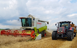 E.j & j.c.j brook agricultural contractors with Combine harvester at Exeter