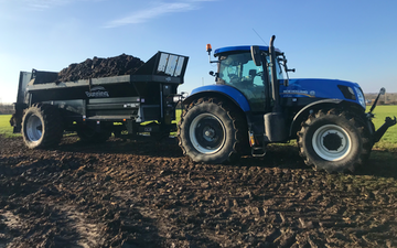 Low haining farm with Manure/waste spreader at United Kingdom