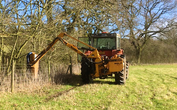 Oxfordshire's agricultural services with Hedge cutter at Boars Hill