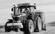 Mains of allanbuie farmers & contractors with Round baler at United Kingdom